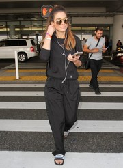 A pair of Adidas slides rounded out Maria Menounos' comfy ensemble.
