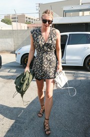 Maria Sharapova completed her outfit with brown lace-up gladiator heels.