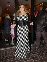 Mariah Carey got in the Christmas spirit wearing this black-and-white tartan gown for shopping in Aspen.