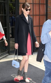 Marion Cotillard stepped out of her hotel rocking silver high-top wedge sandals.