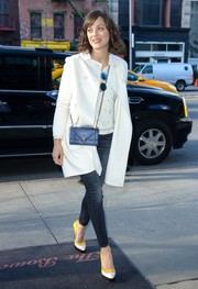 Marion Cotillard looked cozy and stylish in a white wool coat layered over a knit top while out in New York City.