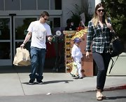 Rhea Durham shopped with family wearing a plaid button-down shirt, a pair of skinny pants, and flat shoes.