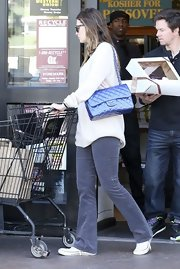 Rhea Durham carried a signature quilted purse while out grocery shopping.
