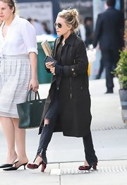 Mary-Kate Olsen stuck to a fashion staple with this black trench.