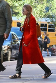 Mary-Kate Olsen stood out in a bright red coat while strolling in New York City.