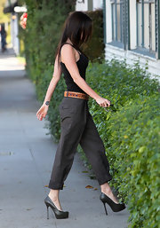 Megan Fox dressed up a basic black tank and cuffed trousers with towering black YSL platform pumps. The Trib Two pumps aren't your average errand running shoes, but they sure look fab on Megan.