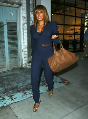 Mel B topped off her second-skin jumpsuit with snakeskin peep-toe pumps.