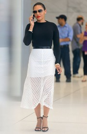 Melanie Brown showed her demure side in a white eyelet midi skirt that showed just a hint of leg.