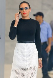 Melanie Brown visited SiriusXM Radio looking chic in oversized sunnies and a monochrome outfit.