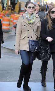 Michelle Trachtenberg was spotted shopping in New York in a pair of flat black suede over the knee boots.