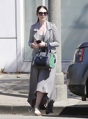 Michelle Trachtenberg chose a light gray, high-low maxi dress to pair with her textured moto jacket.