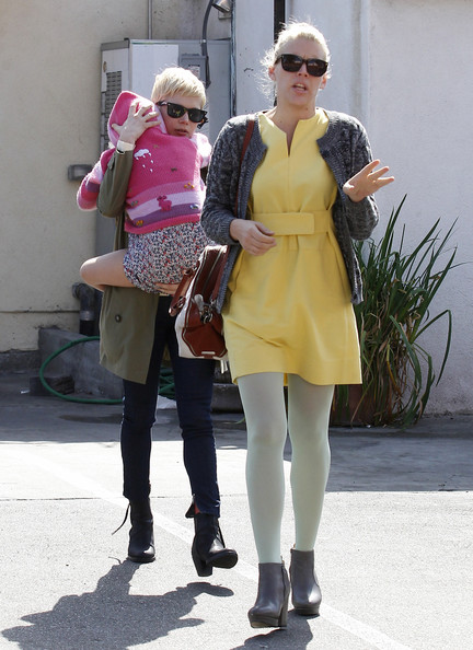 Michelle Williams And Matilda Take Cover Behind Busy Philipps