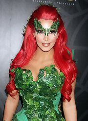 Kim Kardashian added some adhesive leaves and lots of sparkly green eye makeup to her getup at the Midori Green Halloween Hollywood costume party.