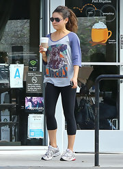 Mila doesn't do yoga in just any ol' ensemble—she rocked this urban baseball tee while getting her zen on.