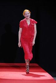 Vivienne Westwood surprisingly opted for a simple red dress during her Spring 2010 fashion show.
