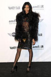 Chanel showed off her Fall 2010 fur coat and sequined cocktail dress while hitting the amfar party.