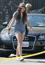 Miley wears distressed denim super short shorts.