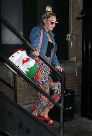 Miley Cyrus looked just like a kid carrying this adorable Oilily Fairy Village backpack while out and about in New York City.