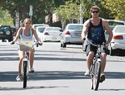 Liam bikes with girlfriend Miley Cyrus in a black tank.