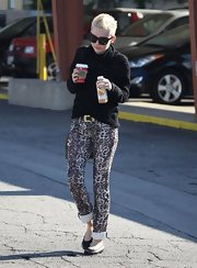Miley stayed warm and cozy in a toasty turtleneck — but kept things funky with leopard-print pants.