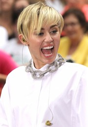 Miley Cyrus wore a mussed-up short 'do with emo bangs when she performed on the 'Today' show.
