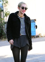 Miley Cyrus headed out on a sunny day in LA wearing a pair of modern round shades.