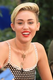 Miley's red pout showed off her pearly whites and made her smile the center of attention!