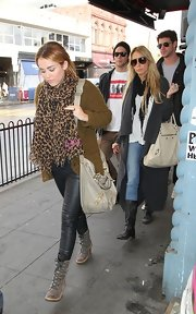 Miley Cyrus stepped out in Melbourne, Australia wearing a pair of well-heeled lace-up ankle boots.