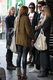 While grabbing lunch in Melbourne, Australia, Miley Cyrus kept it casual by wearing her hair in a simple braid.