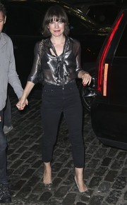Milla Jovovich shimmered in a sheer gunmetal pussybow blouse while out in New York City.
