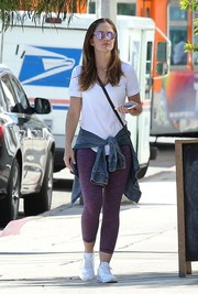 Minka Kelly added some color with a pair of purple leggings.
