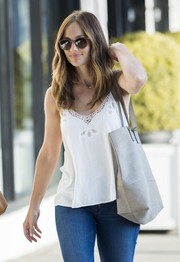 Minka Kelly donned a pair of square shades for some sun protection while shopping.