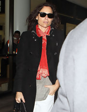 Minnie Driver went incognito at LAX in black wayfarer sunglasses.