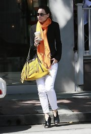 Minnie was spotted leaving lunch in West Hollywood sporting the peep toe Amber booties with cropped jeans.