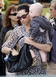 This small tote comes in handy for the actress when trying to juggle a day at the park with her son.
