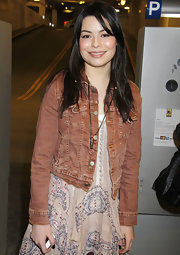 Miranda Cosgrove matched her boho-chic dress with a rust jean jacket.