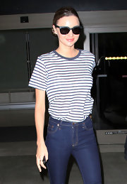 Miranda Kerr channeled the '70s, tucking a loose navy and white striped T-shirt into a pair of high-waist jeans.