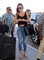 Miranda Kerr teamed her top with ripped, ankle-fray jeans by Mother.