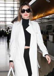 Miranda Kerr kept her oversized shades on as she made her way through LAX.
