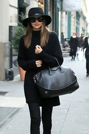 We'd really like to cozy up in a black tunic sweater like Miranda's!