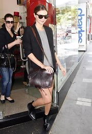 Miranda did some shopping in black ankle boots.
