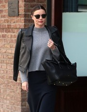 Miranda Kerr headed out in New York City wearing a pair of classic Ray-Ban Clubmaster sunglasses.