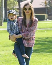 Miranda Kerr channeled her inner-hippie with a loose print blouse while playing with son Flynn in the park.