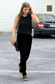 Sofia Richie styled her dark ensemble with a pair of olive-green espadrilles.