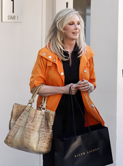 Morgan Fairchild paired a super-stylish snakeskin tote with her casual outfit while out shopping in Beverly Hills.