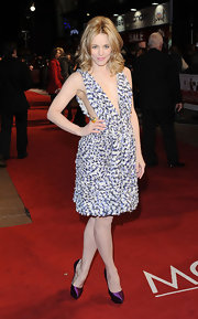 Rachel wore an abstract print dress with a rich texture and a deep plunging bodice.