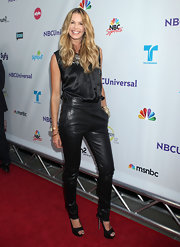 Elle MacPherson put her best foot forward at the 'NBC Universal' Press Tour in a pair of towering black platform peep-toes. The sultry footwear added sass to her tight leather pants.