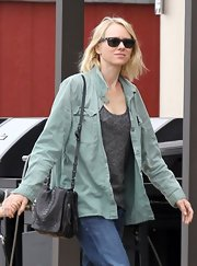 An army green utility jacket made Naomi Watts look casual and comfy while running errands with her family.
