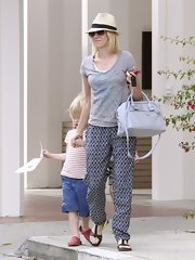 Naomi Watts opted for funky, relaxed silk pants while out in LA with her family.