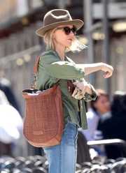 Naomi Watts was spotted out in New York City carrying a stylish woven hobo bag.